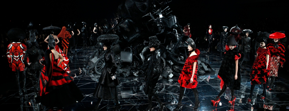 Models present creations by British designer Alexander McQueen during Paris Fashion Week